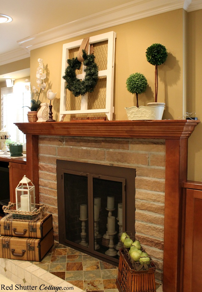 A side view of the fireplace and hearth, simply dressed in natural accessories for the Early Winter Living Room. www.redshuttercottage.com