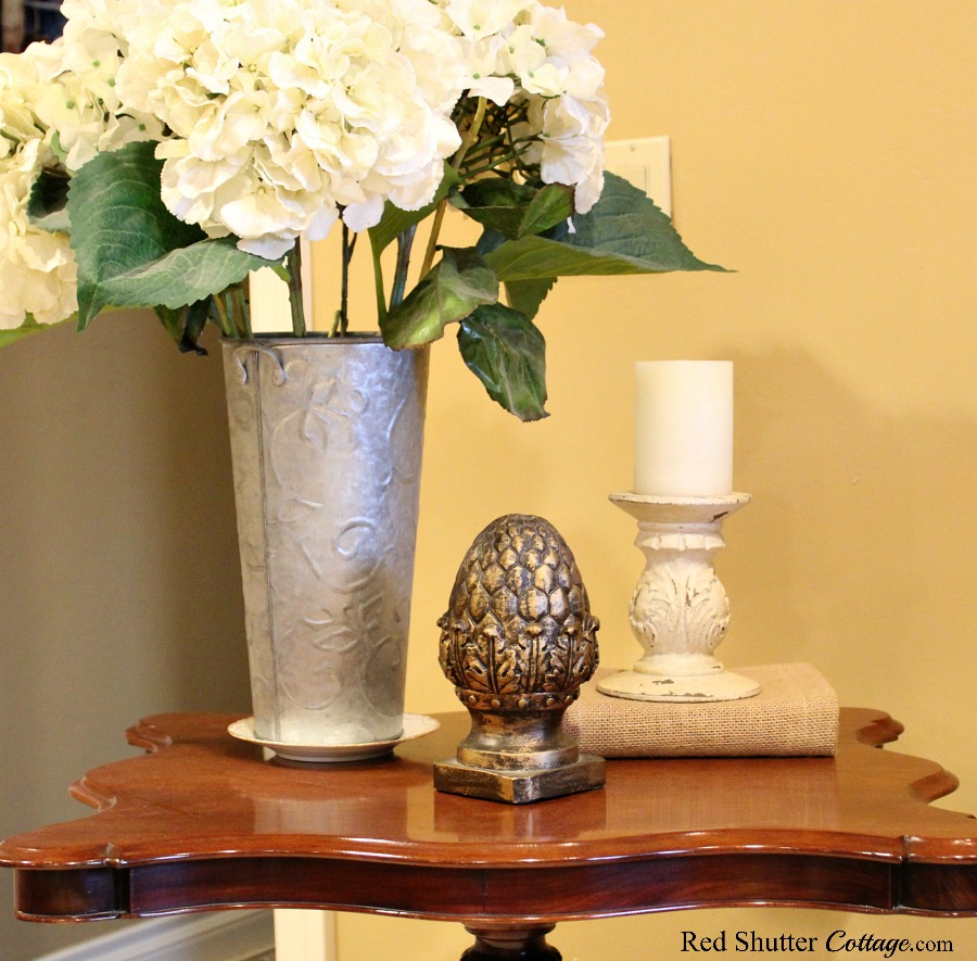 A simple arrangement, including hydrangeas, on the tilt-table in the Early Winter Living Room. www.redshuttercottage.com