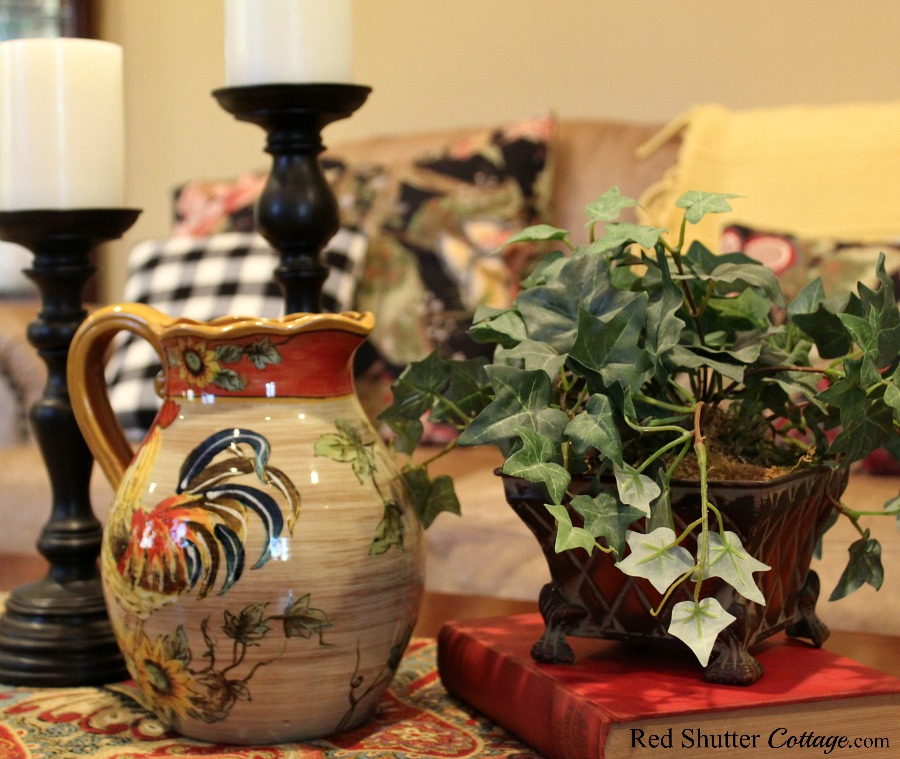 This thrift shop pitcher conveys a warmth to help welcome an Early Winter Living Room. www.redshuttercottage.com