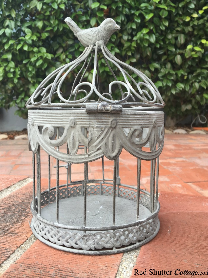 A bird cage with an unholy mess of a finish, before it was re-painted. A great example of The Joy of Treasure Finds by Thrift Shopping. www.redshuttercottage.com