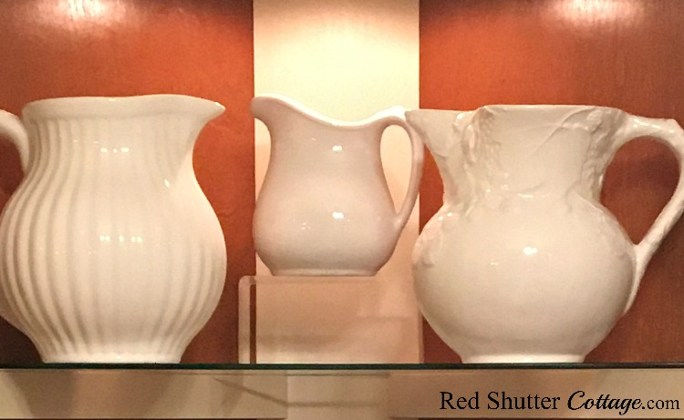My one and only ironstone pitcher (center) that I stumbled onto in a thrift shop. A great example ofA loveseat, captured at a consignment store for a steal! A great example of The Joy of Treasure Finds by Thrift Shopping. www.redshuttercottage.com