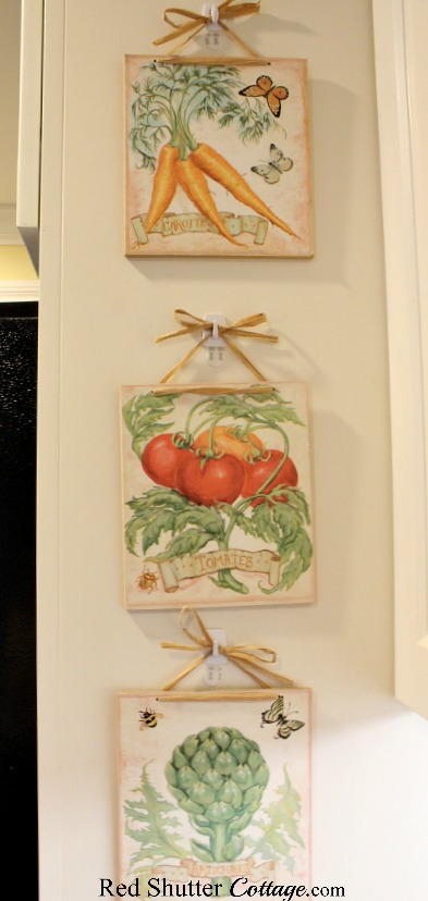 Vegetable plaques from my favorite thrift shop. I think these are older, but still find them unique and timeless. A great example of The Joy of Treasure Finds by Thrift Shopping. www.redshuttercottage.com