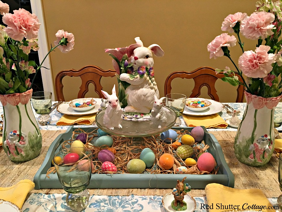 A trio of bunnies on a cake plate, flanked by bunny vases. All of these are thrift store finds, part of 7 Tips for Successful Thrift Shopping. www.redshuttercottage.com