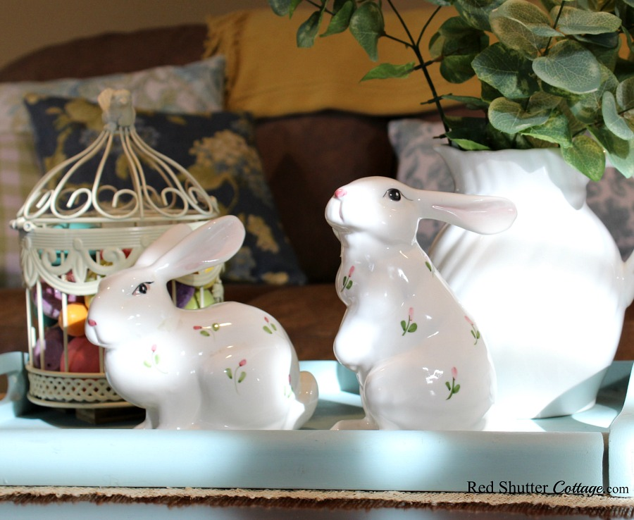 A pair of bunnies tucked into a display case were found in the last hours of an estate sale. Another example of 7 Tips for Successful Thrift Shopping. www.redshuttercottage.com