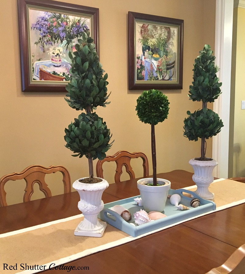 Too tall topiaries creating drama on our dining table. A great example of The Joy of Treasure Finds by Thrift Shopping. www.redshuttercottage.com