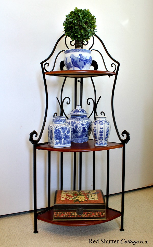 This charming corner shelf unit folds up into a flat size that is easily stored. A great example of The Joy of Treasure Finds by Thrift Shopping. www.redshuttercottage.com