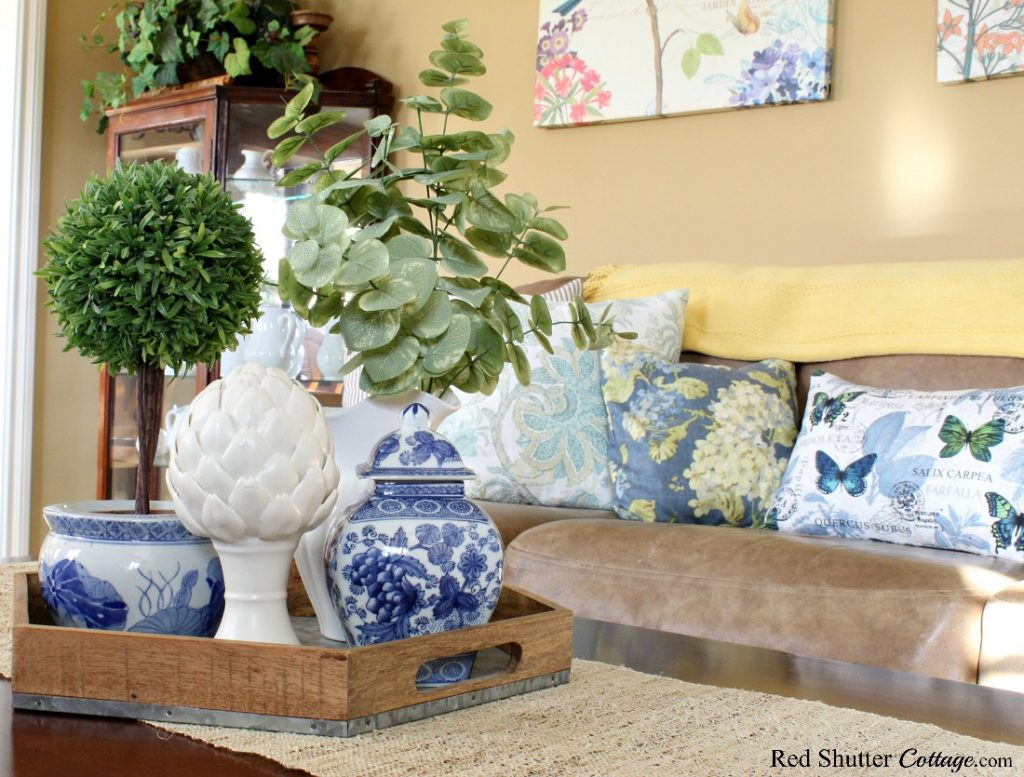 Blues, whites and greenery brighten up my springtime living room. www.redshuttercottage.com