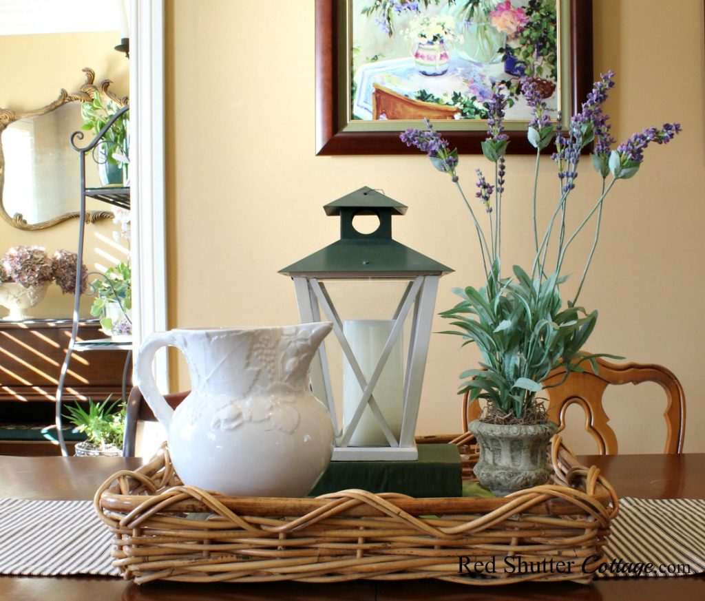 Lavender and black ticking are part of a dining table vignette in a springtime living room. www.redshuttercottage.com