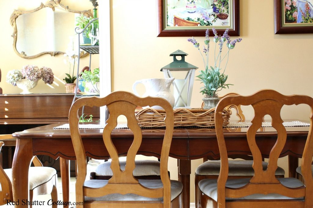 The dining table is set with a happy, casual vignette for a springtime living room. www.redshuttercottage.com