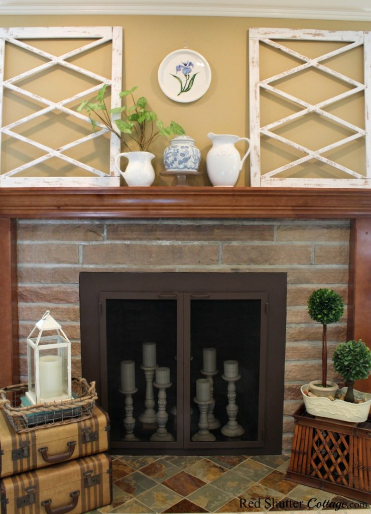 A bright and simple mantel and hearth is part of my springtime living room. www.redshuttercottage.com
