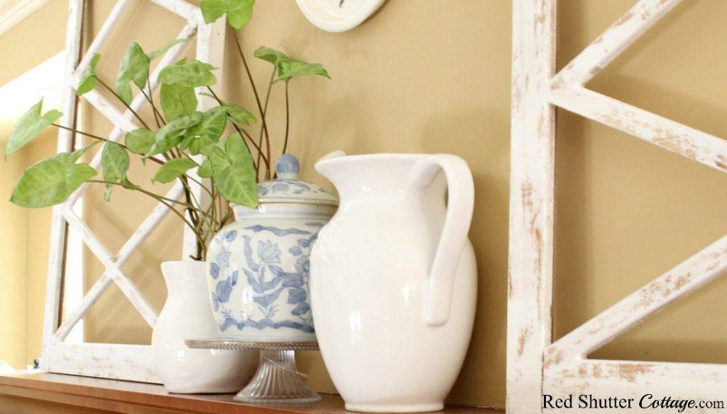 A happy plant brings fresh greenery to this mantel in my springtime living room. www.redshuttercottage.com